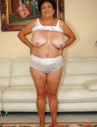 Fatty granny in undergarments gets bare to display her wet pussy