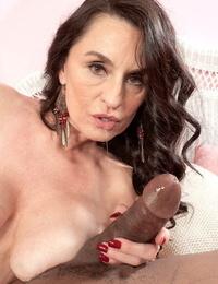 Scorching mature lady Rita Daniels seduces a captured guy in a crimson sundress