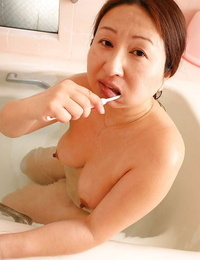 Chubby asian granny with saggy tits Miyoko Nagase taking bathtub