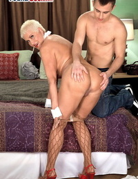 Molten grandmother with short hair seduces her talented fucktoy in fishnet tights