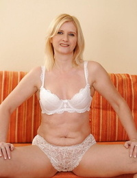 Well-graced granny in undergarments getting naked and exposing her twat