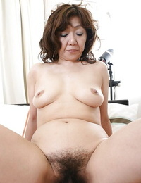 Asian lady Eriko Nishimura gives a deep throat and gets her shaggy slit boned-up