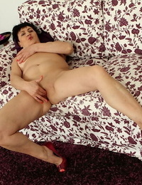Scorching granny Karoline stretching legs and finger fucking hairless mature pussy