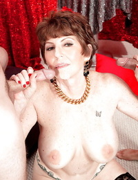 Bosomy granny in stockings Bea Cummins treats 2 cocks at the same time