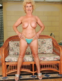 Thick squirted granny in undergarments undressing and demonstrating her gloryhole
