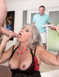 Wild granny Silva Foxx deep throats off 2 guys while her hubby is coerced to watch