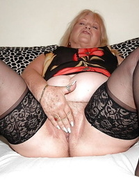 Fatty granny in nylon blossom disrobing and touching her puss