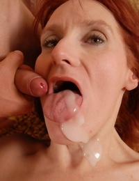 Sexy redhead granny Debra undresses and nails in doggy stance