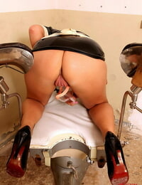 Wild babe in uniform is into fetish taunting her pussy with gyno stuff
