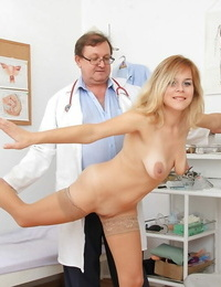 Blonde milf Karen is being checked by her nasty doctor in glasses
