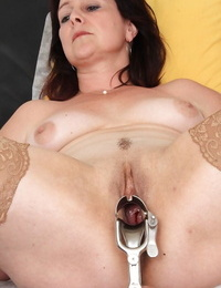 Mature chick Simi undresses and bare-breasted beaver for checkup with gyno doctor