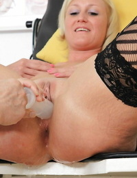 Older ash-blonde woman Lenny having speculum inserted into vagina
