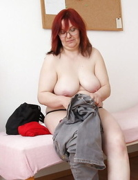 Round granny with flabby baps undressing in the gyno office