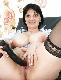 Wild mature Nurse in stockings shoving playthings into her pulsating twat