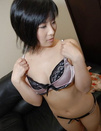 Asian stunner Minori Nagakawa disrobing down and unveiling her wooly cunt
