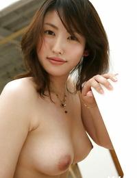 Seductive asian stunner Takako Kitahara sliding off her clothes