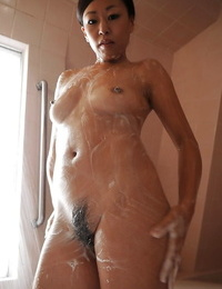 Asian stunner Kayoko Ikehata is toying with her fur covered vagina on webcam