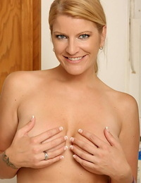 Blond Mummy Robbye Honeck unveiling large all natural hooters in kitchen