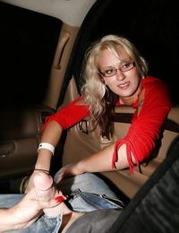 Lascivious mature blond gives a sensuous handjob in the car