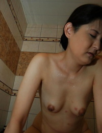 Nectar asian Mummy gives a soapy handjob and blows a stiff cock in the bathroom