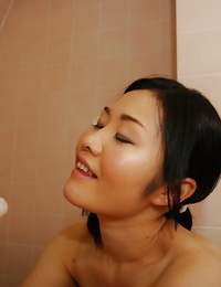 Delicious looking asian babe Megumu washing dick and giving a handjob