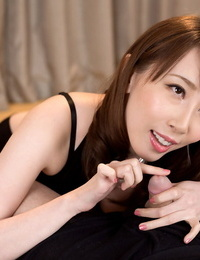 Clothed Japanese slobber-filled jerks off a cock after a no thong upskirt