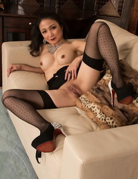 Asian mummy Aya May has her booty shown in wonderful high heels and blossom