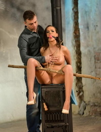 Dark-haired girl Linet Slag has her clothes cut away after being ball-gagged and tied