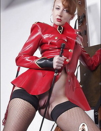 Mature fetish damsel in latex suit exposing her ample ballsack and bald slit