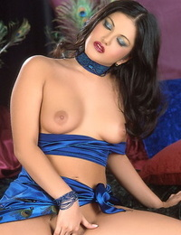 Beautiful Indian female Sunny Leone pets her coochie with her hooters out