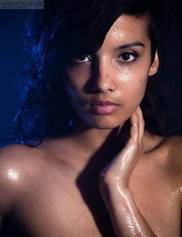 Indian woman demonstrates off her thick natural knockers while modeling in the nude