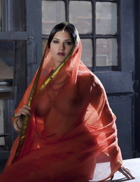 Big-titted solo chick Sunny Leone models solo in observe thru Indian apparel