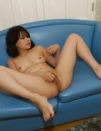 Naughty asian MILF Yukari Yamagishi getting bare and toying with a massager