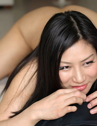 Japanese nymph licks nut nectar off of her thumbs after a POV hand job