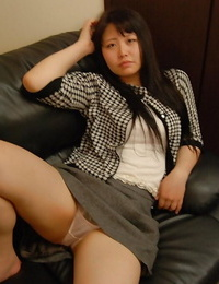 Asian slobber-filled strips and gets her vagina pleased with magic wand under her subjugation
