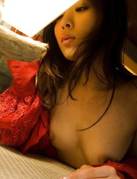 Naughty asian babe with diminutive tits taunting her hairy puss on the couch