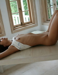Handsome asian babe with petite arse revealing her titties and hairy cunt