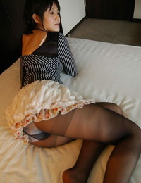 Dirty-minded asian Mummy Seiko Kuramoto disrobing on the bed