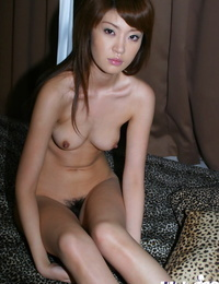 Naughty asian chick uncovering her yanks hooters and furry muff