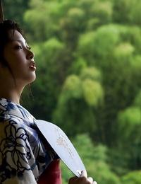 Bosomy asian bombshell Saki Koto unveiling her inviting figure