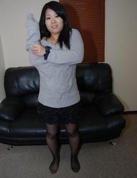 Asian teenager Natsuki Arai striping down and spreading her lower lips