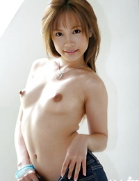 Adorable asian stunner with sexy gams Reika Shina slipping off her clothes