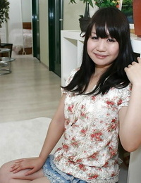 Asian teenager with no subjugation under her miniskirt exposing her shaved gash