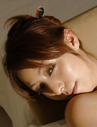 Naughty asian girl with tempting assets toying with a magic wand