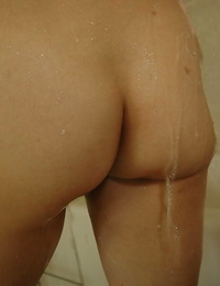 Slim asian MILF takes shower and has some cunt vibing fun