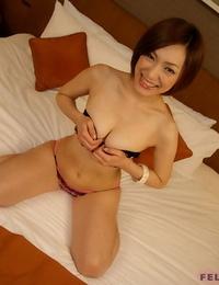 Diminutive Japanese woman Iino Nene gives a blowjob on her knees