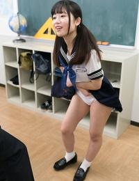 Slurps Japanese schoolgirl hoists her mini-skirt to masturbate for teacher in class