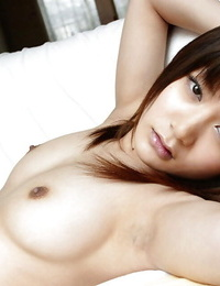 Spectacular asian honey Noa Aoki uncovering her tits and taking off her cut-offs