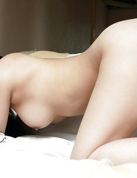 Lusty asian babe Noa Aoki taking off her lingerie and stretching her gams