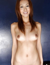 Alluring asian babe with amazing knockers stripping off her clothes
